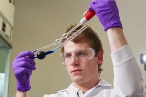 man holding capillary viscometer